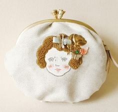 girl embroidered on purse. exquisit art and wonderful idea Love how the hair stands out