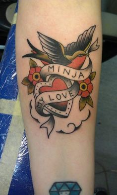 heart and swallow name tattoo