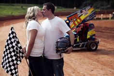 Love On The Speedway, Race Track Engagement Photos With Checkered Flags Beer Showers