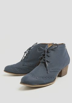 Rendered in soft faux leather, these navy-hued, oxford-style booties feature a classic perforated design and a lace-up closure. Finished with an almond-shaped toe and a faux stacked heel, these b...