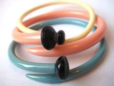 I'd actually wear these! Cute.  Recycled Vintage Knitting Needle Bracelets by Etsy's sewnewthings