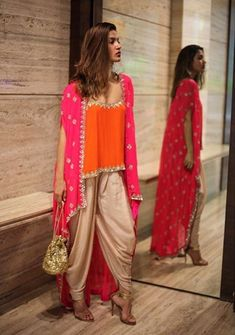 The perfect Festivewear Ensemble! Cami , Cape & Dhoti pants , and the Mirror Potli, Shop this and much more at Design One, days… Saris, Indian Attire, Indian Wear, Pakistani Dresses, Indian Dresses, Ethnic Fashion, Asian Fashion, Lehenga, Anarkali