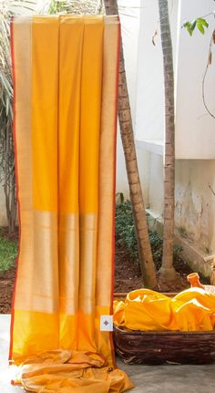 FABULOUS PASTEL ORANGE IS INTRICATELY WOVEN IN YELLOW HAS INTRICATELY WOVEN GOLD BORDER AND PALLU GIVING THE SAREE CAPTIVATING FINISH.
