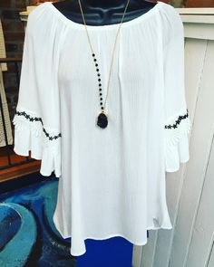 Just add some black skinny jeans! White flowy top with lace details- $32.95 Black stone statement necklace- $18.95 #madisonsbluebrick #downtownhotsprings #winterfashion #shoplocal