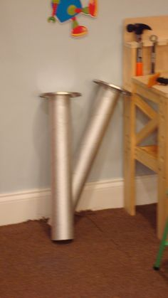 VBS   looks like to make large screws using a carpet tube cut with a large can lid and then paint silver?