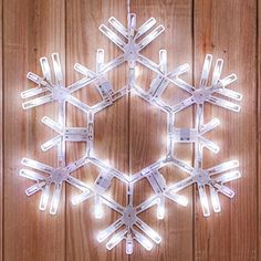 Hanging Twinkle Snowflake - 20 Inch Cool White Outdoor LED Snowflake Twinkles with 70 Lights Kringle Traditions http://www.amazon.com/dp/B00WZN2UJE/ref=cm_sw_r_pi_dp_3d8uwb17KYEM9