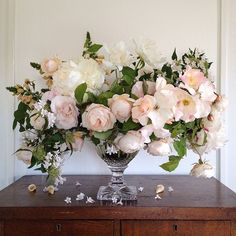 Soft pink roses in crystal vase
