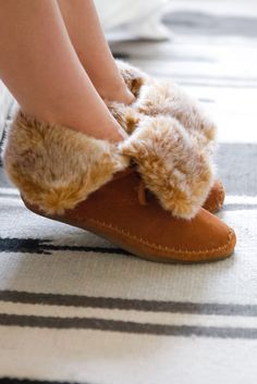 Soft and comfy for lounging around the house or running errands. The TOMS Zahara booties are lined with faux shearling and feature a fold over top for a laid-back look.