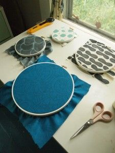 Another tutorial on embroidery hoops and fabric wall art.