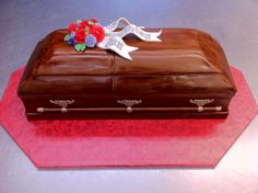 - This cake was done for a funeral director's birthday and is, believe it or not, based on his favorite casket.  A lot of fun to do, especially since I am the daughter of an embalmer myself.