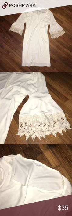 """Flowy tunic style long shirt/dress Originally from Reddress boutique ( an online boutique). Super cute white flowy tunic style long shirt/dress. Quarter flowy sleeves with knitted lace at the bottom of the sleeve. Scoop neckline, with double layer/built in slip so it's not see-through. Never worn perfect condition. Approximately 36"""" in length shoulder to bottom. Sleeves are approximately 17"""" in length. PEACH LOVE CA Tops Tunics"""