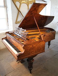 An 1888, Bechstein Model C grand piano with an exquisite, burr walnut case at Besbrode Pianos. Piano has turned legs and a filigree music desk. £24,000
