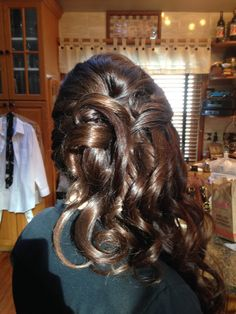 A lot of hair to the side updo style