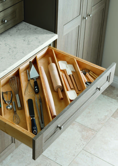 Say goodbye to tangled kitchen gadgets with #MarthaStewartLiving drawers designed to store utensils of any size.