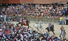 Horses are paraded through the main square of Siena, Italy, during a training session on the eve of the Palio medieval race on August 15, 2012