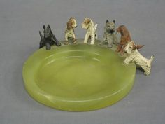 Art Deco circular green marble and cold painted bronze ashtray in the form of a pool, the edge with 6 dogs -  Denhams