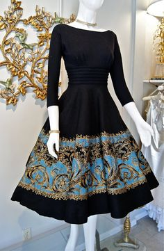 "This was in Miss Elliette's fashion heyday. Made in the 1950's and featuring a ""New Look"" sillouette with a full felt circle skirt and fitted wool jersey bodice."