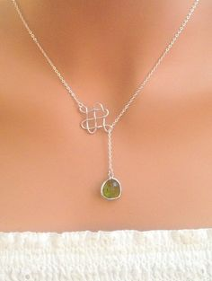 Infinity Knot with olivine stone sterling silver necklace. Bridal. Wedding. Bridesmaids Gift. Everyday Wear. In Silver.