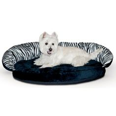 Plush Bolster Sleeper Pet Bed - Zebra Print from RadioFence.com is the best of both worlds for the dog or cat that loves plush fleece and the comfort of a bolster bed. Made from 100% polyester plush fabric. Generously stuffed with polyfil for the dogs that like to nest. Only $33.95!!  (http://www.radiofence.com/plush-bolster-sleeper-pet-bed-zebra-print/)
