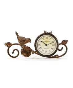 Bird Table Clock. Constructed from metal, this bird-themed table clock accents your kitchen or living room décor with ease [10.6'' W x 4.7'' H x 3'' D] Requires 1 AA Battery [Not included] $19.99
