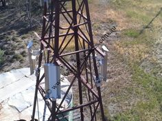 A high up shot looking back down to the 3 x Ubiquiti rockets strapped to the back of 3 x Ubiquiti sector panels mounted at up the tower. North Western, Rockets, Looking Back, Utility Pole, Westerns, Shots, Tower, Travel, Rook