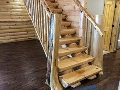 Milled half log tread staircase with flare butt tree newels.