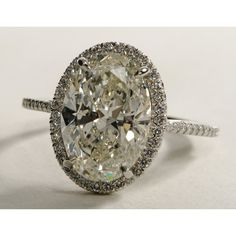 Oval Halo Diamond Engagement Ring found on Polyvore