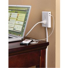 The Wall Mounted Outlet Extender - Hammacher Schlemmer. This power outlet mounts to a wall up to 6' away from an existing outlet, providing more convenient access to AC and USB power.