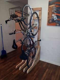 Upright wooden bike storage and racks. | Shared by velojoy.com