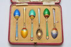 A Cased set of antique silver enamel spoons