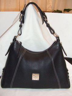 Black Dooney and Bourke leather shoulder bag.    Very soft leather, roomy inside.