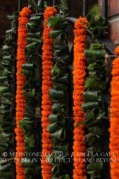orange marigold garlands, traditional Indian wedding flowers