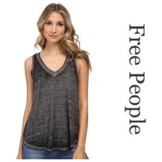 NWT Free People Breezy Tank Brand new with tags gray breezy tank from Free People. The actual color is heather grey. I also have a white one in a medium in my closet.  stock photos from Belk's website and Zappos.com Free People Tops Tank Tops