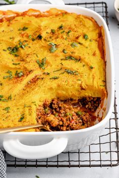 Deliciously savory, Indian-inspired shepherd's pie recipe made with lean ground turkey, veggies an a perfectly spiced potato topping. This lightened up shepherd's pie recipe makes a wonderful, hearty fall dinner that you can even freeze and serve later! #shepherdspie #indian #comfortfood #glutenfree #grainfree #fallrecipe #healthydinner