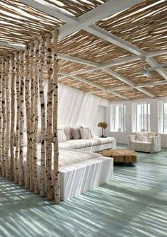 Cool way to use birch..... outdoor seating area??