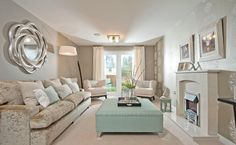 Interior Designed Formal Living Room.  Fabulous minky silver metallic velvets, shell pink, taupe and linen wallpaper with gorgeous mint green accents.  Slightly beachy, Palm Springs feel to this room.  Bellway Homes 2015
