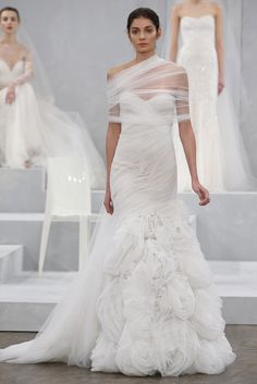 Don't know how I feel about the top tulle piece but love the rest...Monique Lhuillier Spring 2015 Bridal | PreOwned Wedding Dresses