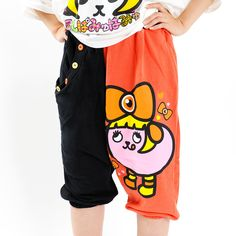 Kyary Pamyu Pamyu is a fashion and pop icon, but she's also quite well-known for her cute quirks! These comfortable fleece-lined pants featuring Mame Pamyu show off that cute quirkiness with a *tehe-pero* expression on the left leg and right back pocket! There is also a front pocket on the right side lined with buttons giving the pants a very trendy non-symmetrical look.  They're available in he...