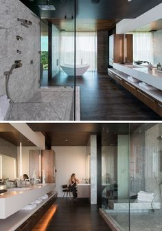 In this modern master bathroom, there's a freestanding bath that sits beside the window, as well as a glass enclosedCarrara marble shower and quartz counters. #MasterBathroom #ModernBathroom