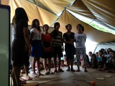 Kids making presentation after worship in Arapal.