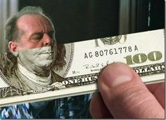 This is a money illusion where the guys face almost looks like it fits perfectly on the 100 dollar bill.