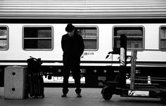 Wait or greet a love away in time  While approaching to your heart while with a hug  smile at the meeting in an empty station only  While it will remain in the memory of the time that train