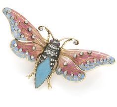 A plique-à-jour enamel, ruby and diamond moth brooch.