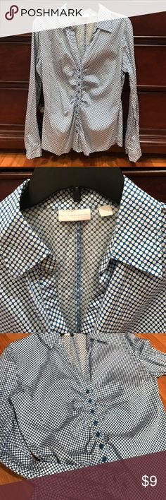 New York and Co polka dot button up shirt Gorgeous blue with white polka dot button up top. Buttons are a beautiful blue as well. Sides are bunched it to give it a textured look and a slimming effect. Sleeves have buttons are the wrist as well. Size Large 98% cotton 2% spandex. Excellent condition! New York & Company Tops Button Down Shirts