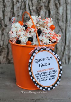 Ghostly Grub Recipe with free tag - Cute, easy and YUM!  Popcorn, white chocolate candy melts, pretzel sticks, orange and black sixlets and orange and black sprinkles.