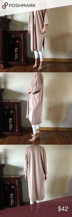 "✨Nude Open Cardigan Duster✨ This nude colored open cardigan/duster has 3/4 length sleeves and a loose, flowy fit. Looks awesome with skinnies or even leggings..definitely has a good weight to it and it has almost a ""silky"" feel to it. Love it! ❤️ Price firm.  I'm 5'7"" modeling the Small Polyester/Spandex Pit to Pit: S-27"" M-28"" L-29"" Length: 46"" Sweaters Cardigans"