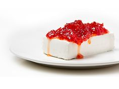 Roasted red pepper jelly and cream cheese make a festive, delicious appetizer.