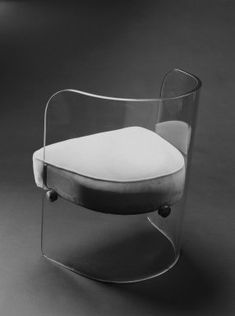 Armchair  Designer: Louis Dierra  Manufacturer: Pittsburgh Plate Glass Company  Medium: Glass, modern upholstery, metal fittings  Place Manufactured: Pittsburgh, Pennsylvania, USA  Dates: ca. 1939