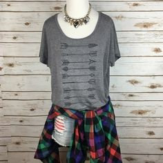 """[Boho Luxe] Arrow Graphic Tee Casual Beach Gypsy Easy to wear graphic t. Wide neck with dolman sleeves. Curved hemline. Comfortable with a looser fit. Fun sketched arrow pattern on front.  Fabric: Polyester/Cotton/Rayon Bust: 19"""" Length: 25"""" Condition: EUC. No flaws. Like new.  No Trades! Next Level Tops Tees - Short Sleeve"""
