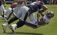 Ray Lewis (Baltimore Ravens, 2013 champions) hitting another player.